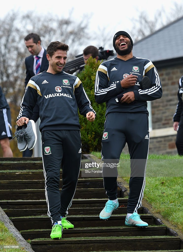 Wales captain Ashley Williams (r) shares a joke with Joe Allen before Wales football training ahead of tomorrow's UEFA Euro 2016 qualifying match against Belguim on November 15, 2014 in Cardiff, Wales.