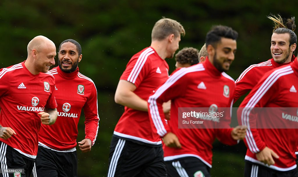 Wales captain <a gi-track='captionPersonalityLinkClicked' href=/galleries/search?phrase=Ashley+Williams+-+Soccer+Player&family=editorial&specificpeople=13495389 ng-click='$event.stopPropagation()'>Ashley Williams</a> (2nd left) shares a joke with team mates during Wales training at their Euro 2016 base camp ahead of their Quarter Final match against Belguim, on June 28, 2016 in Dinard, France.