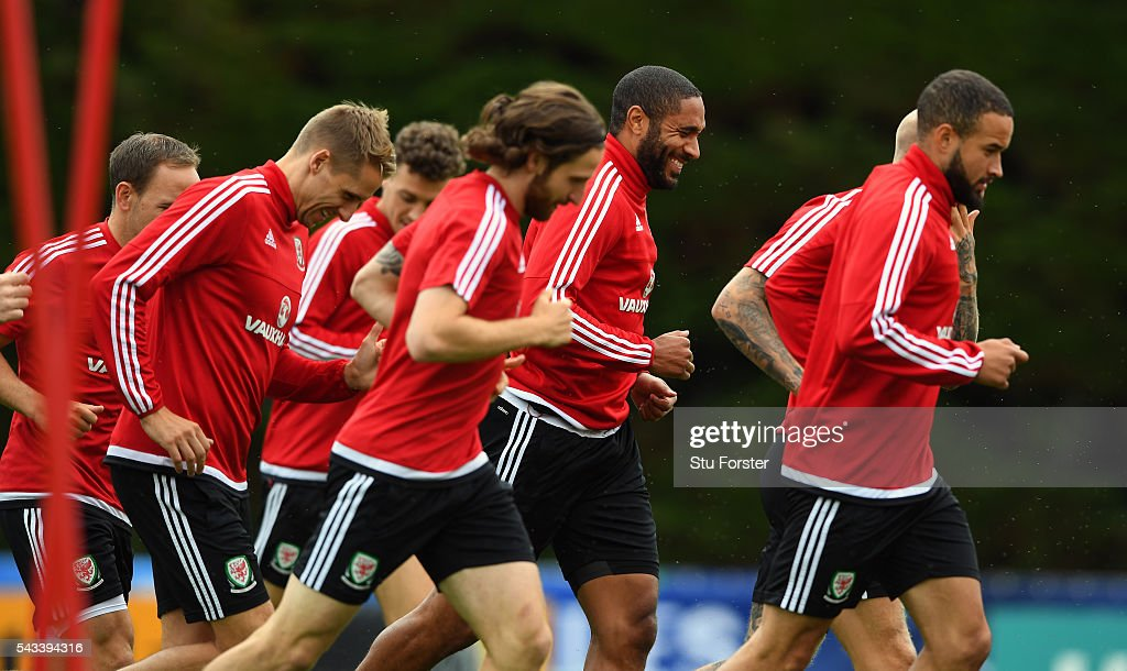 Wales captain <a gi-track='captionPersonalityLinkClicked' href=/galleries/search?phrase=Ashley+Williams+-+Soccer+Player&family=editorial&specificpeople=13495389 ng-click='$event.stopPropagation()'>Ashley Williams</a> (c) shares a joke with team mates during Wales training at their Euro 2016 base camp ahead of their Quarter Final match against Belguim, on June 28, 2016 in Dinard, France.