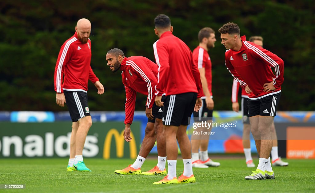 Wales captain <a gi-track='captionPersonalityLinkClicked' href=/galleries/search?phrase=Ashley+Williams+-+Soccer+Player&family=editorial&specificpeople=13495389 ng-click='$event.stopPropagation()'>Ashley Williams</a> (2nd left) stretches during the Wales training session ahead of their Euro 2016 quarter final match against Belgium at their base camp on June 30, 2016 in Lille, France.