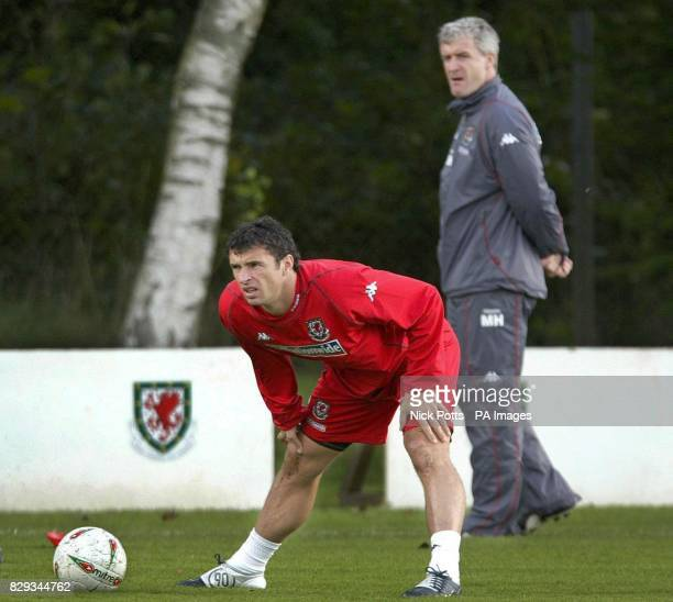Wales' captain Gary Speed warms up under the watchfull eye of Manager Mark Hughes before playing England in World Cup Qualifier at Old Trafford...