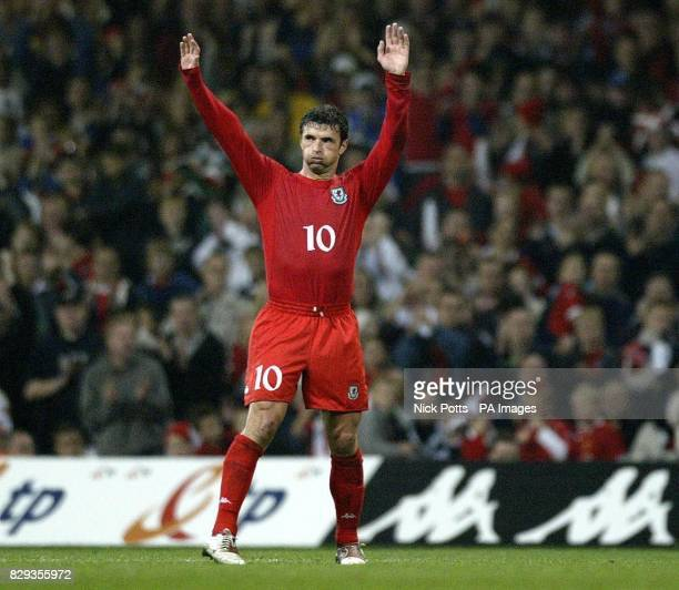 Wales' captain Gary Speed waves to crowd after he is taken off by manager Mark Hughes during the World Cup qualifier at the Millennium Stadium...
