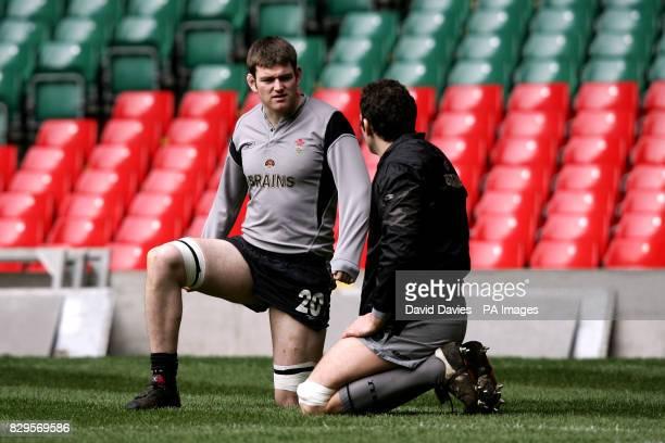 Wales captain Michael Owen chats to Jonathan Thomas during training