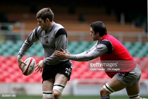 Wales' captain Michael Owen passes under pressure from Jonathan Thomas during training
