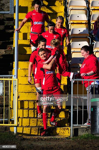 Wales captain Rachel Taylor and her team enter the field before the Women's Six Nations championship match between Wales and England at St Helens RFC...