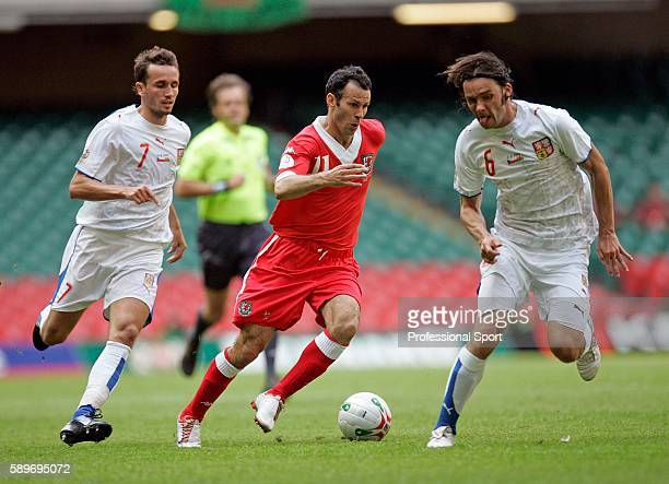 Wales captain Ryan Giggs goes past Marek Jankulovski and Tomas Sivok of the Czech Republic during the Euro 2008 Group D Qualifying Match between...