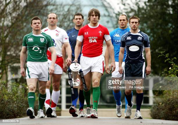 Wales captain Ryan Jones holds the RBS Six Nations Trophy as he leads his fellow captains Mike Blair of Scotland Sergio Parisse of Italy Lionel...