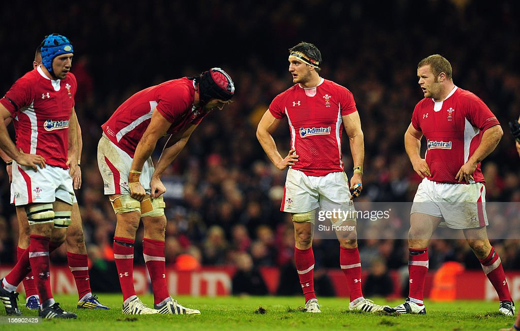 Wales captain <a gi-track='captionPersonalityLinkClicked' href=/galleries/search?phrase=Sam+Warburton+-+Rugby+Player&family=editorial&specificpeople=4234449 ng-click='$event.stopPropagation()'>Sam Warburton</a> (2nd R) and dejected team mates look on during the International Match between Wales and New Zealand at Millennium Stadium on November 24, 2012 in Cardiff, Wales.