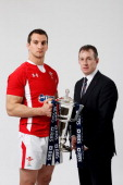 Wales captain Sam Warburton and Rob Howley the Wales interim head coach pose with the Six Nations trophy during the RBS Six Nations launch at The...