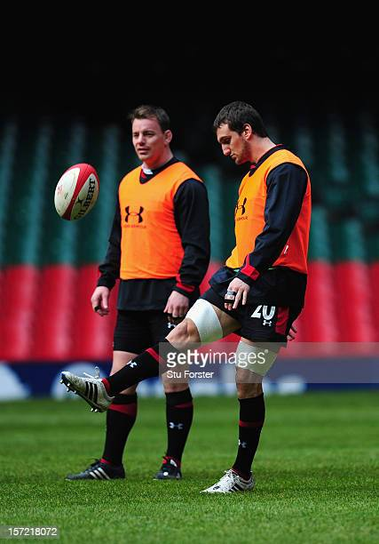 Wales captain Sam Warburton in action as Matthew Rees looks on during the Wales Captain's Run ahead of Saturdays game against the Australian...