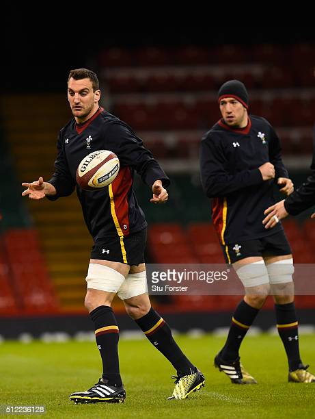 Wales captain Sam Warburton in action watched by Justin Tipuric during the Wales captain's run ahead of their RBS Six Nations match against France at...