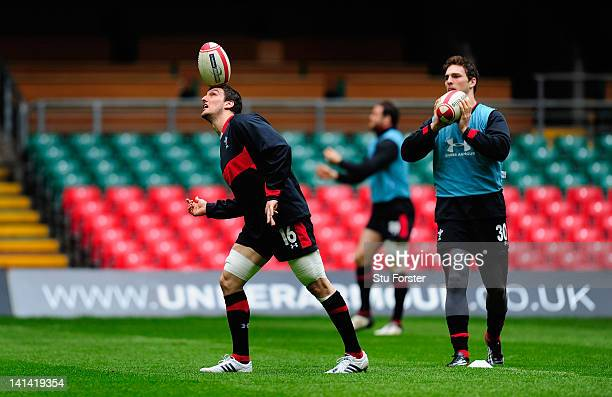 Wales captain Sam Warburton in action watched by winger George North during the Wales Captain's Run ahead of tomorrows RBS six nations game against...