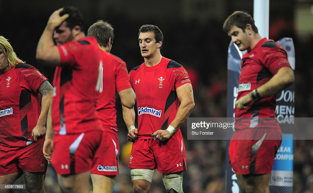 Wales captain <a gi-track='captionPersonalityLinkClicked' href=/galleries/search?phrase=Sam+Warburton&family=editorial&specificpeople=4234449 ng-click='$event.stopPropagation()'>Sam Warburton</a> (c) reacts after a wallabies try during the International match between Wales and Australia Wallabies at Millennium Stadium on November 30, 2013 in Cardiff, Wales.