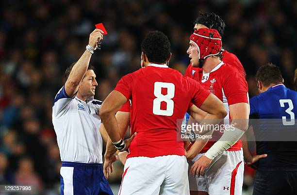 Wales captain Sam Warburton receives a straight red card from Referee Alain Rolland of Ireland for a dangerous tackle on Wing Vincent Clerc of France...