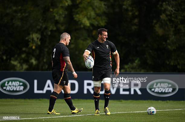 Wales captain Sam Warburton shares a joke as Paul James looks on during a Wales training session at the Vale hotel on September 16 2015 in Cardiff...