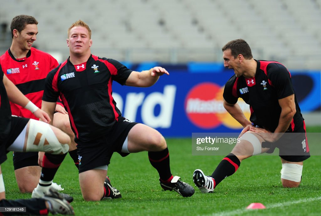 Wales captain <a gi-track='captionPersonalityLinkClicked' href=/galleries/search?phrase=Sam+Warburton+-+Rugby+Player&family=editorial&specificpeople=4234449 ng-click='$event.stopPropagation()'>Sam Warburton</a> (R) shares a joke with wing <a gi-track='captionPersonalityLinkClicked' href=/galleries/search?phrase=George+North&family=editorial&specificpeople=7320853 ng-click='$event.stopPropagation()'>George North</a> (L) during a Wales IRB Rugby World Cup 2011 captain's run at Eden Park on October 14, 2011 in Auckland, New Zealand.
