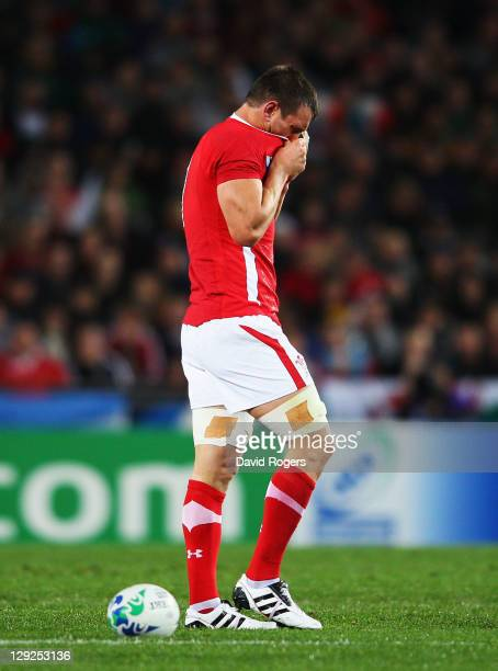 Wales captain Sam Warburton walks off the pitch after receiving a straight red card for a dangerous tackle on Wing Vincent Clerc of France during...