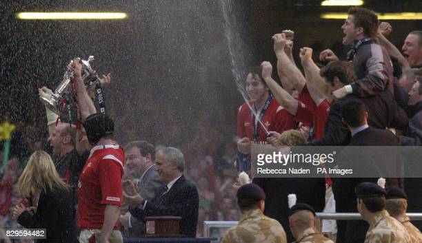 Wales' captains Gareth Thomas and Michael Owen hold the RBS 6 Nations Trophy after defeating Ireland 32 20