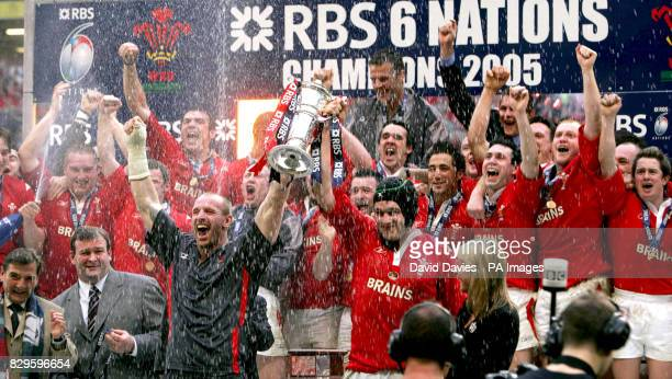 Wales' captains Gareth Thomas and Michael Owen hold the RBS 6 Nations Trophy after defeating Ireland