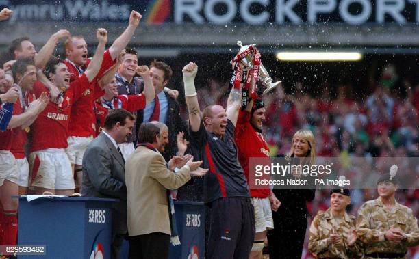 Wales' captains Gareth Thomas and Michael Owen hold up the RBS 6 Nations Championship trophy after their victory over Ireland