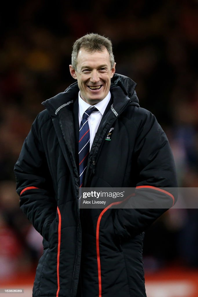Wales caretaker coach <a gi-track='captionPersonalityLinkClicked' href=/galleries/search?phrase=Rob+Howley&family=editorial&specificpeople=215419 ng-click='$event.stopPropagation()'>Rob Howley</a> celebrates his team's victory following the final whistle during the RBS Six Nations match between Wales and England at Millennium Stadium on March 16, 2013 in Cardiff, Wales.