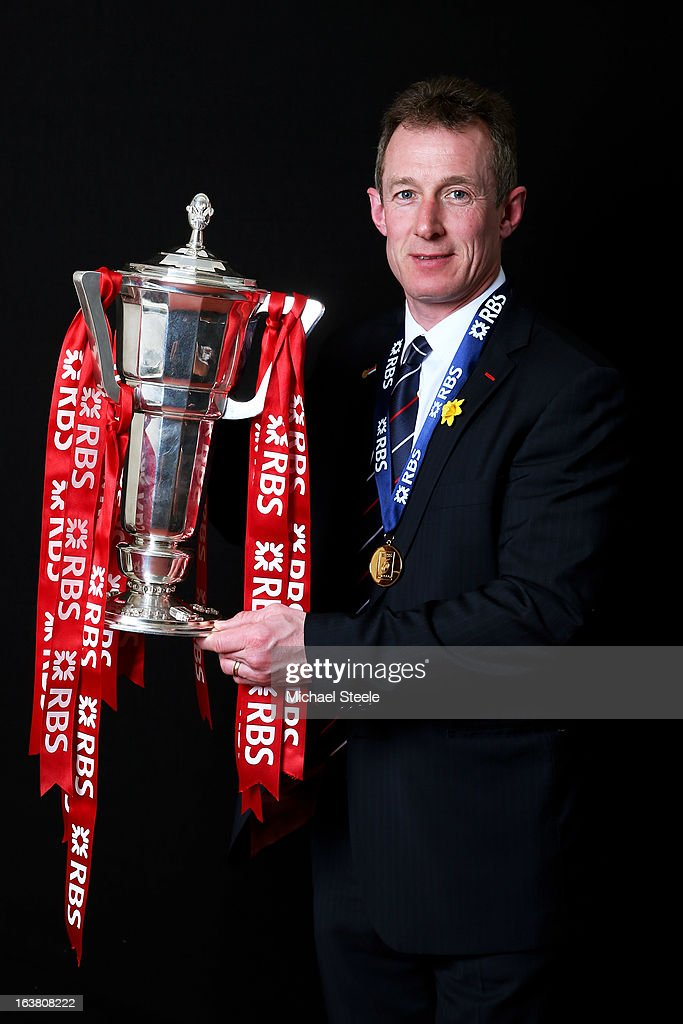 Wales caretaker coach <a gi-track='captionPersonalityLinkClicked' href=/galleries/search?phrase=Rob+Howley&family=editorial&specificpeople=215419 ng-click='$event.stopPropagation()'>Rob Howley</a> poses with the Six Nations trophy following his team's victory during the RBS Six Nations match between Wales and England at Millennium Stadium on March 16, 2013 in Cardiff, Wales.