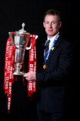 Wales caretaker coach Rob Howley poses with the Six Nations trophy following his team's victory during the RBS Six Nations match between Wales and...