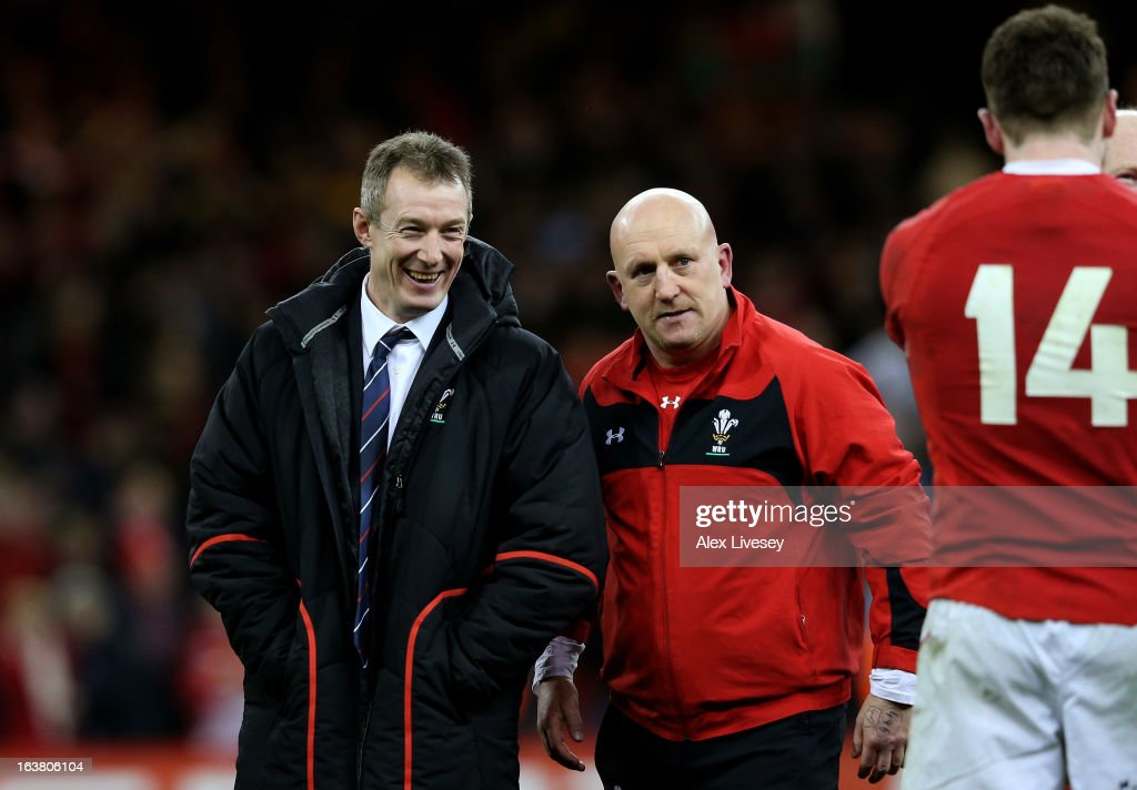 Wales caretaker coach <a gi-track='captionPersonalityLinkClicked' href=/galleries/search?phrase=Rob+Howley&family=editorial&specificpeople=215419 ng-click='$event.stopPropagation()'>Rob Howley</a>, Wales defence coach <a gi-track='captionPersonalityLinkClicked' href=/galleries/search?phrase=Shaun+Edwards+-+Rugby+Player&family=editorial&specificpeople=15368723 ng-click='$event.stopPropagation()'>Shaun Edwards</a> and Wing <a gi-track='captionPersonalityLinkClicked' href=/galleries/search?phrase=Alex+Cuthbert&family=editorial&specificpeople=6143846 ng-click='$event.stopPropagation()'>Alex Cuthbert</a> #14 of Wales celebrate their team's victory following the final whistle during the RBS Six Nations match between Wales and England at Millennium Stadium on March 16, 2013 in Cardiff, Wales.