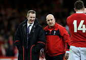 Wales caretaker coach Rob Howley Wales defence coach Shaun Edwards and Wing Alex Cuthbert of Wales celebrate their team's victory following the final...