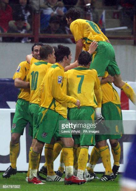 Wales celebrate with Joseph Ledley after he scored during the World Cup Qualifying match at the Lokomotiv Stadium Moscow Russia
