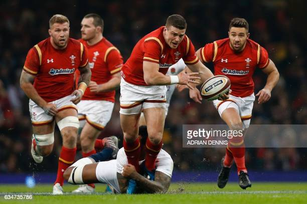 TOPSHOT Wales' center Scott Williams breaks through the England defence during the Six Nations international rugby union match between Wales and...