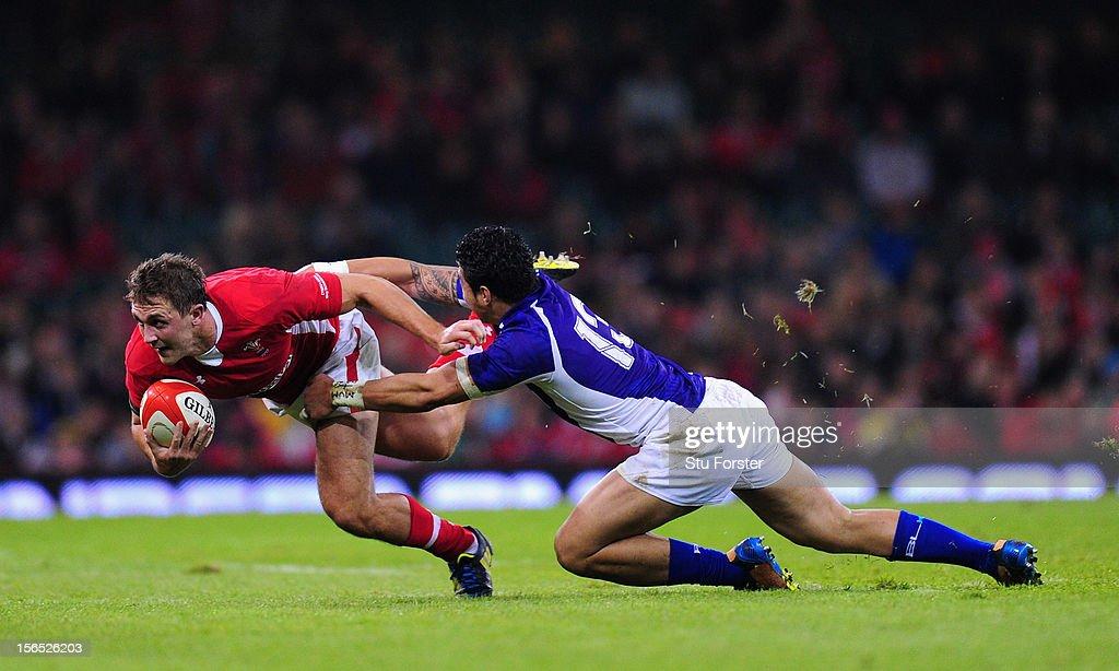 Wales centre Ashley Beck (l) is tackled by the George Pisi of Somoa during the International Match between Wales and Samoa at Millennium Stadium on November 16, 2012 in Cardiff, Wales.