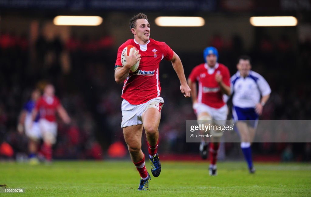 Wales centre Ashley Beck runs in his interception try during the International Match between Wales and Samoa at Millennium Stadium on November 16, 2012 in Cardiff, Wales.