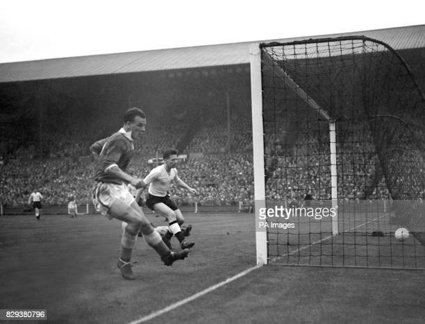 Wales' centre forward John Charles shoots into a empty net to notch the first goal for his country in the international football match against...
