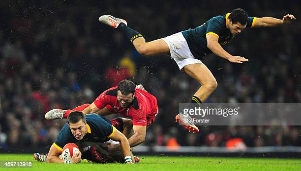 Wales centre Jamie Roberts tackles Handre Pollard as Jan Serfontein goes flying during the Autumn international match between Wales and South Africa...