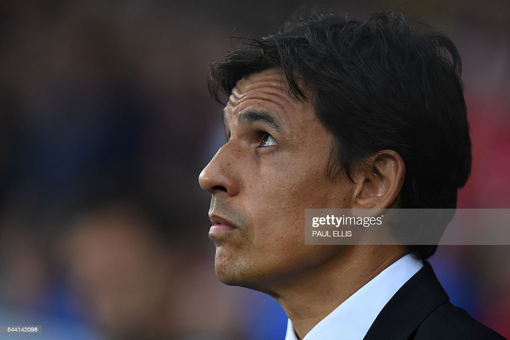 Wales' coach Chris Coleman attends the Euro 2016 quarter-final football match between Wales and Belgium at the Pierre-Mauroy stadium in Villeneuve-d'Ascq near Lille, on July 1, 2016. / AFP / PAUL