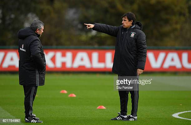 Wales coach Chris Coleman chats with assistant manager Osian Roberts during training ahead of their way to training ahead of their World Cup...