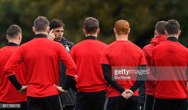 Wales coach Chris Coleman gives his players instructions ahead of their way to training ahead of their World Cup Qualifier against Serbia at the Vale...
