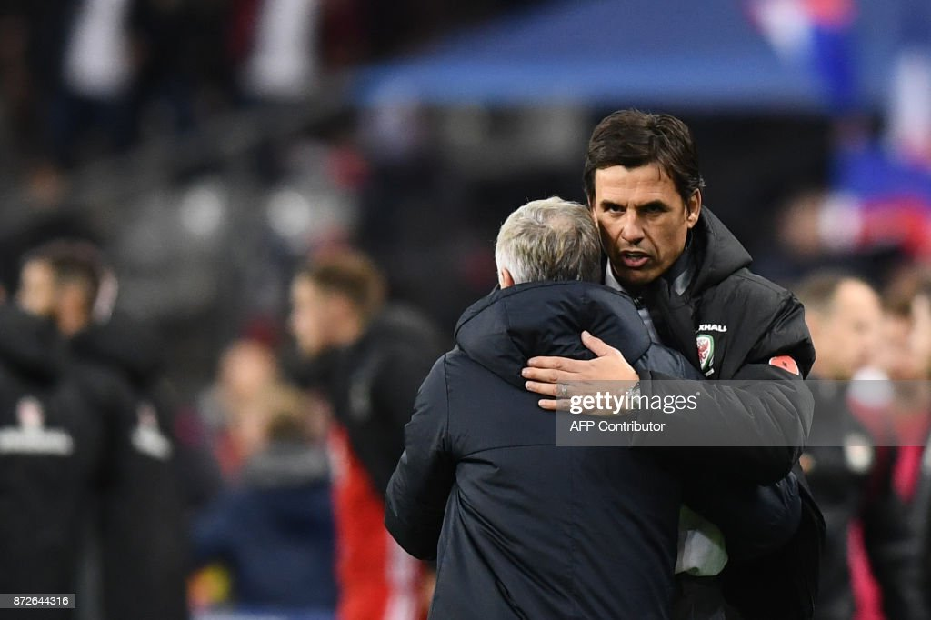 Wales' coach Cris Coleman (R) congratulates France's coach Didier Deschamps (L) at the end of the friendly football match between France and Wales at the Stade de France stadium, in Saint-Denis, on the outskirts of Paris, on November 10, 2017. /