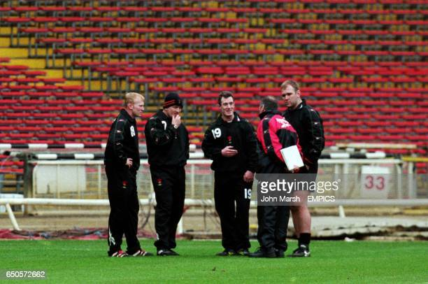 Wales coach Graham Henry talks tactics with Wales's Neil Jenkins Rob Howley and Scott Quinnell