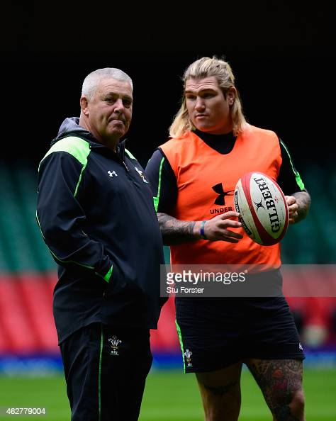 Wales coach Warren Gatland chats with hooker Richard Hibbard during Wales training ahead of friday's opening Six Nations match against England at...
