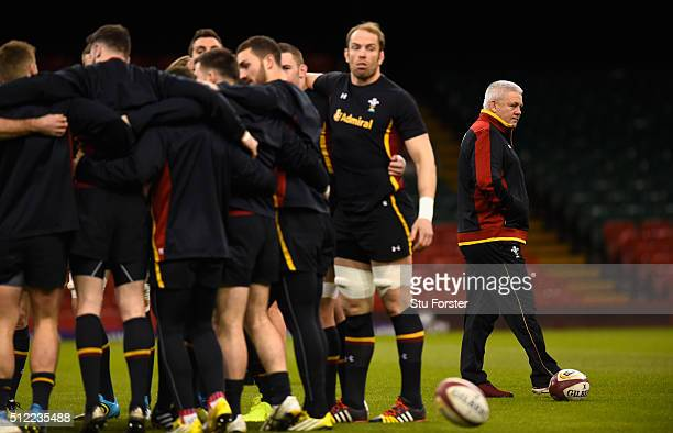 Wales coach Warren Gatland looks on as his team engage in a huddle during the Wales captain's run ahead of their RBS Six Nations match against France...