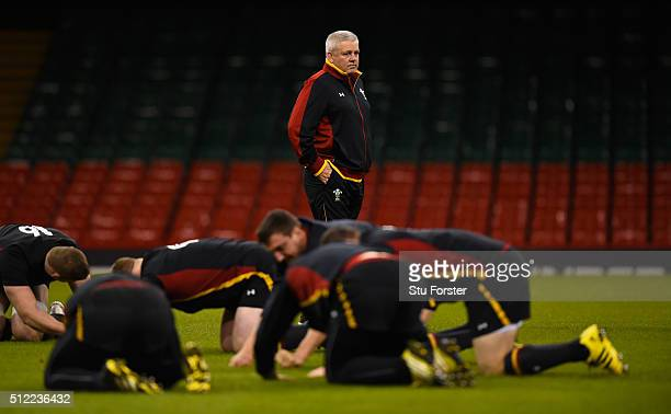 Wales coach Warren Gatland looks on as his team stretch during the Wales captain's run ahead of their RBS Six Nations match against France at...