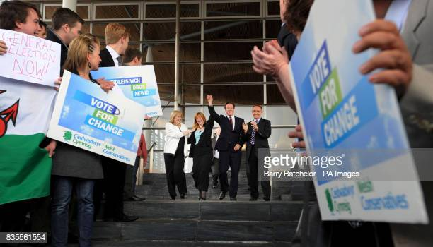 Wales Conservative MEP Kay Swinburne and Conservative Party leader David Cameron are greeted by supporters at the Senedd in Cardiff Bay