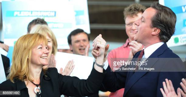 Wales Conservative MEP Kay Swinburne greets Conservative Party leader David Cameron on the steps of the Senedd in Cardiff Bay