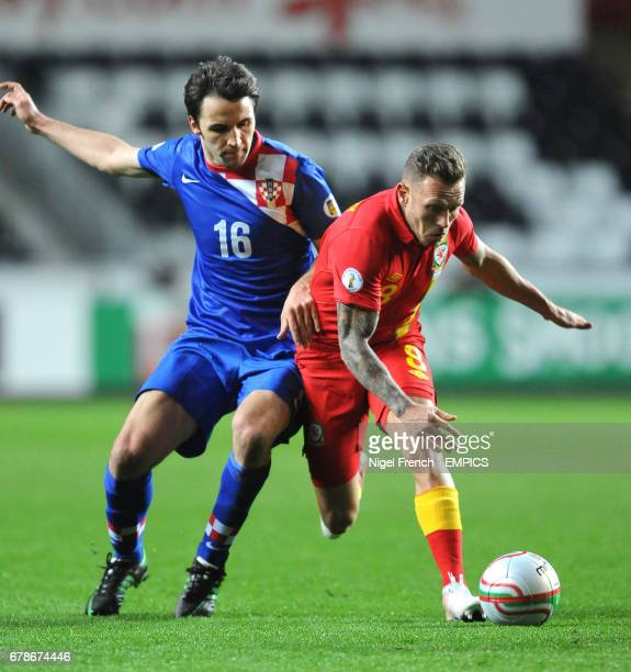 Wales' Craig Bellamy and Croatia's Milan Badelj battle for the ball
