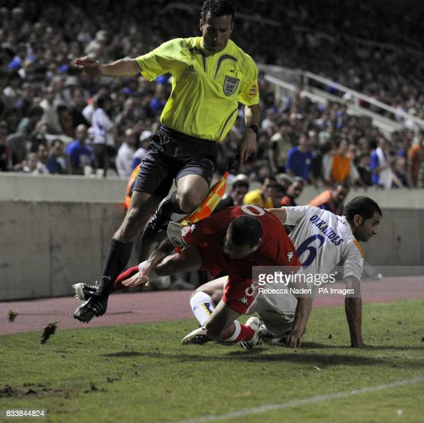 Wales Craig Bellamy collides with linesman after tackle during the UEFA European Championship Qualifying match at Neo GSP Stadium Nicosia Cyprus