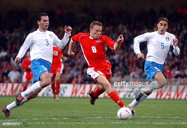 Wales' Craig Bellamy takes on Italy's Luciano Zauri and Fabio Cannavaro during Euro 2004 Group 9 Qualifying match at the Millennium Stadium Cardiff
