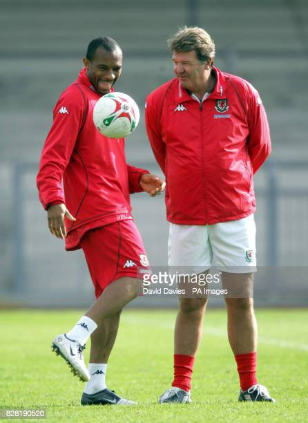 Wales' Daniel Gabbidon talks with coach John Toshack during a training session at Newport County Ground Tuesday October 4 2005 Wales are to play...