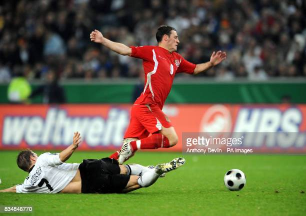 Wales' David Edwards avoids a challenge from Germany's Bastian Schweinsteiger during the FIFA World Cup Qualifying match at Borussia Park...